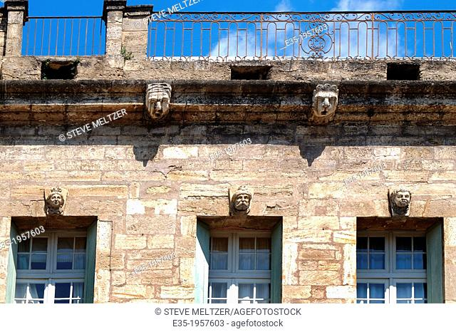 The faces of local politicians are immortalized in the facade of this building