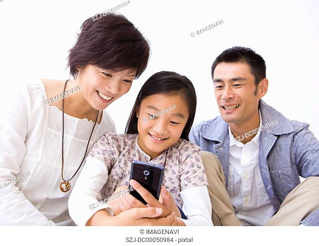 Family using a smartphone
