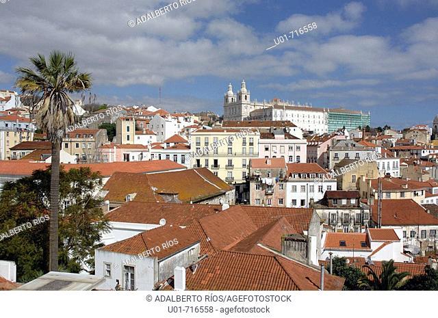 View of Alfama quarter from Miradouro (viewpoint) da Graça, São Vicente monastery in background. Lisbon, Portugal