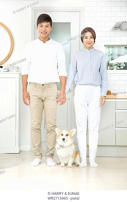 Smiling couple with pet