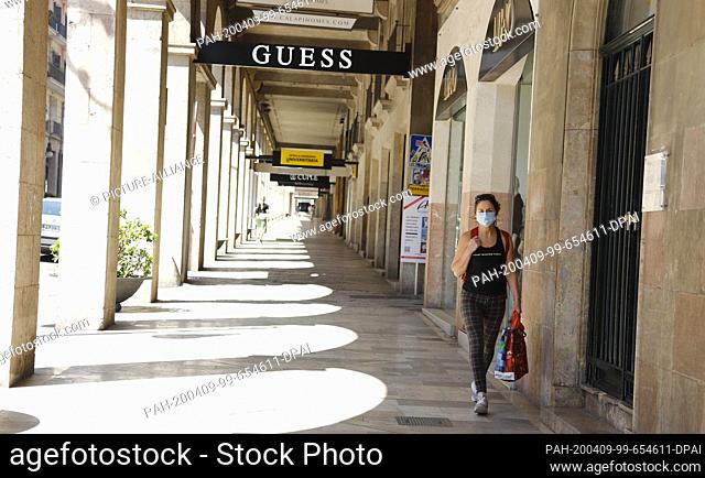 09 April 2020, Spain, Palma de Mallorca: Only a few people walk along the Jaume III road. In the fight against the coronavirus pandemic