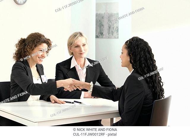 Two business women conduct an interview