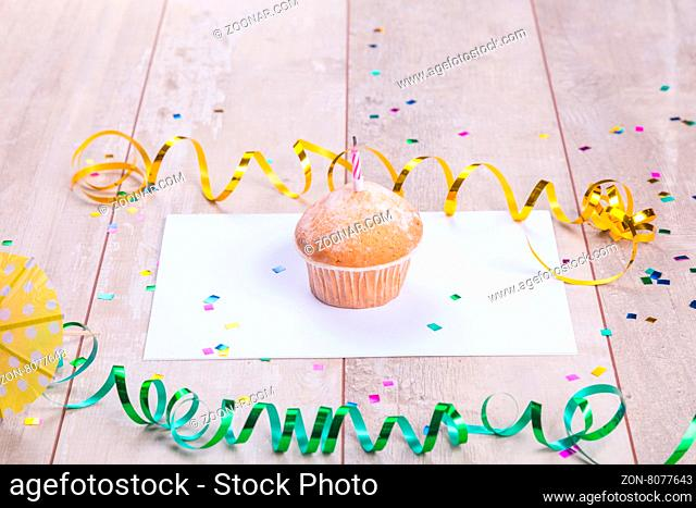 Birthday cupcake on table wood background