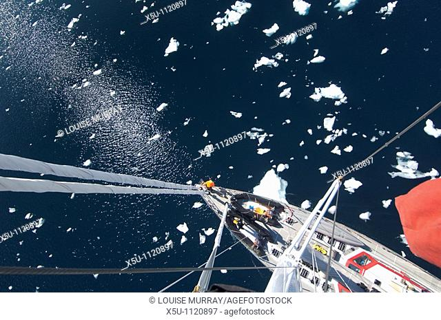 View from the top mast of the Pelagic Australis yacht in Antarctic waters at Pleneau Island
