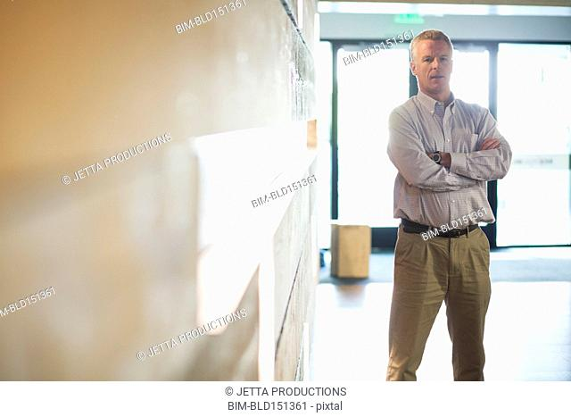 Caucasian businessman standing in office