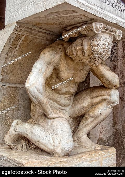 The Hunchback of Rialto (Il Gobbo di Rialto) in the Campo San Giacomo is a statue of a kneeling figure supporting a staircase leading to a column - Venice