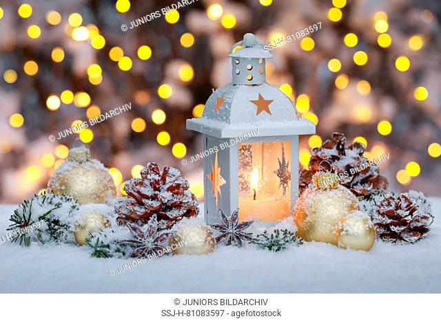 Lantern with Christmas decoration in snow. Switzerland