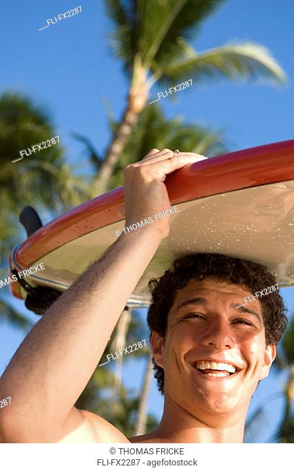 Man with Surfboard on Head, Maui, Hawaii