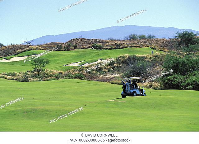 Hawaii, Big Island, Hapuna Prince Golf Course, Golfers in cart