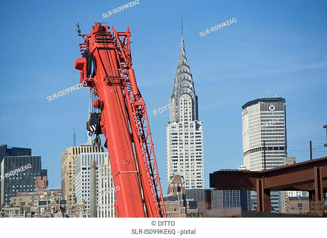 Crane and buildings in New York City, USA