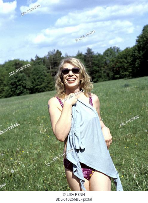 woman (35-40 years) in swimsuit walking towards camera