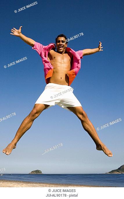 Man jumping at beach