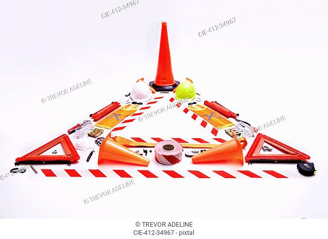 Still life concept construction equipment forming hazard triangle