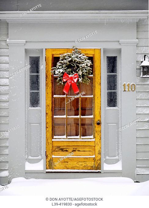 Christmas decorations on door. Amherst, Massachusetts. USA