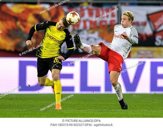 15 March 2018, Austria, Salzburg: Football: Europa League, RB Salzburg vs Borussia Dortmund at the Red Bull Arena. Dortmund's Lukasz Piszczek (l) and Salzburg's...