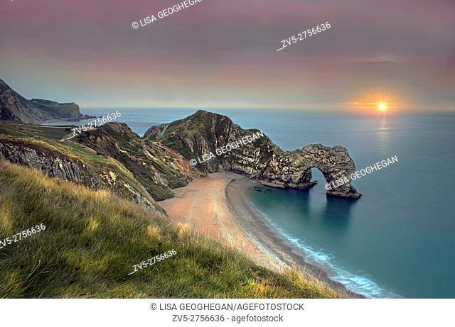 Durdle Door along the Jurassic Coast at sunrise. Dorset, England, Uk, Gb