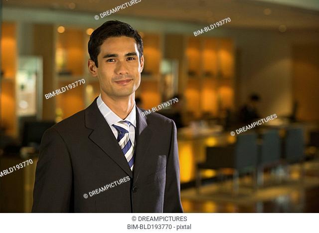 Businessman smiling in bar