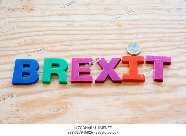 Brexit text on wooden background