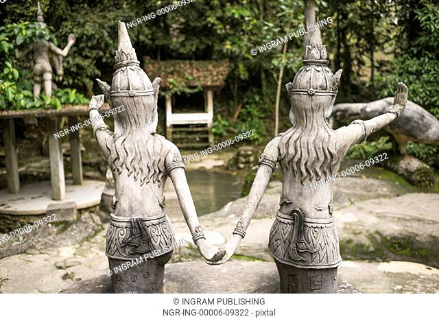 Rear view of two statues in Heaven's Garden, Koh Samui, Surat Thani Province, Thailand