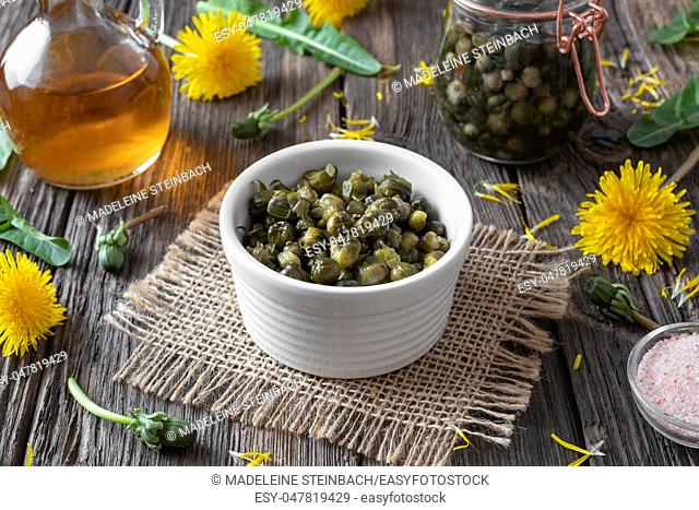 False capers made from dandelion buds in a bowl on a table