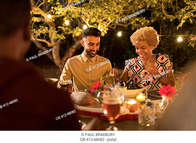 Couple enjoying dinner garden party