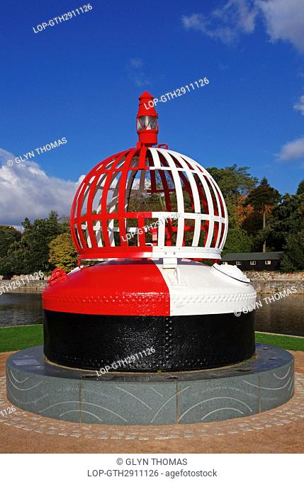 England, Devon, Exeter. Restored buoy on the quayside at the junction of the River Exe and the Exeter ship canal