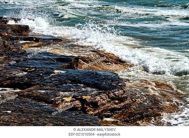 Waves break on the rocks