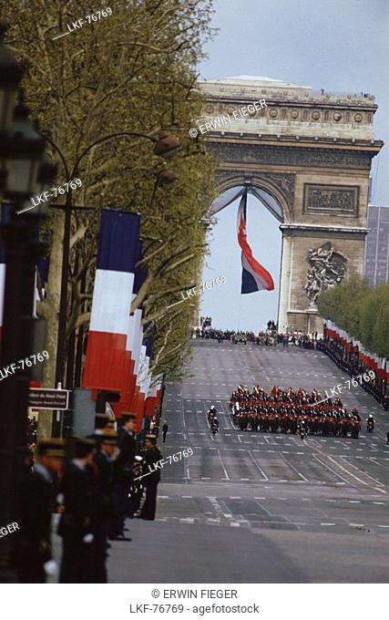 Soldiers marching from Arc de Triomphe, Paris, France