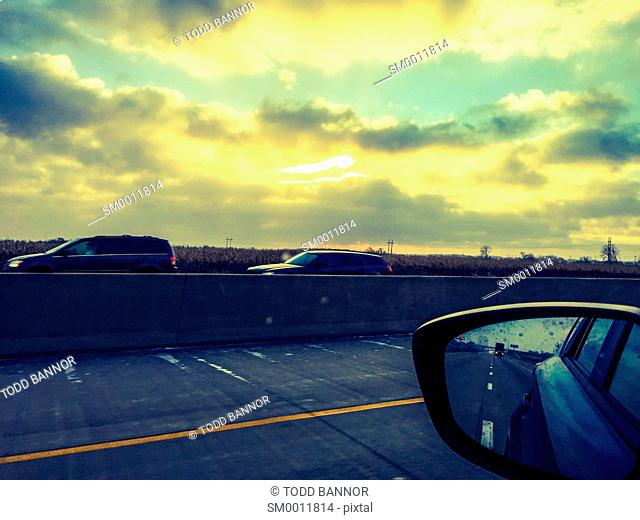 Driving an interstate highway at sunrise