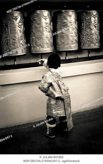 Buddhist and prayer wheels to celebrate Losar, the Tibetan New Year at the Dalai Lama temple, McLeod Ganj, India