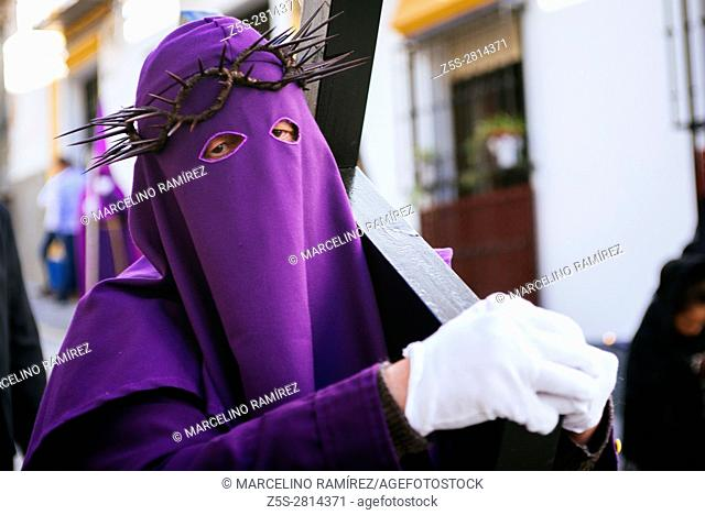 Nazarene wearing the cross of penance. Friday morning. Alcalá La Real. Jaén. Andalusia. Spain