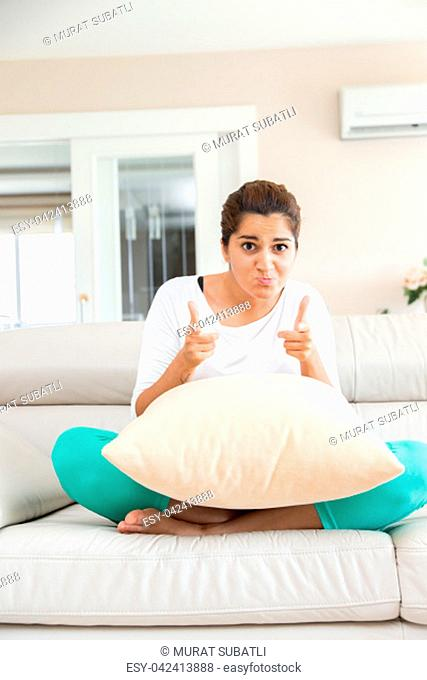 Young woman in livingroom