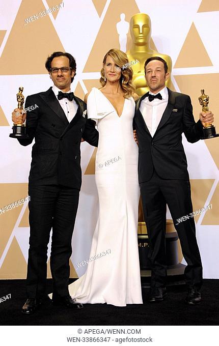 The 90th Annual Academy Awards Press Room Featuring: Laura Dern, Dan Cogen, Bryan Fogel Where: Los Angeles, California, United States When: 05 Mar 2018 Credit:...