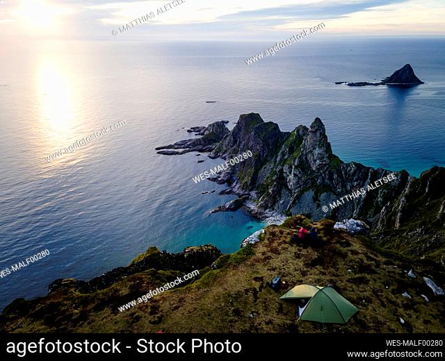Explorers camping on mountain at Matind, Andoya, Norway