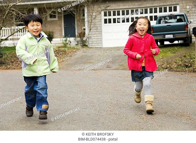 Korean children running in street