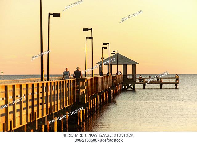 The fishing pier at sunset on the Gulf of Mexico in Biloxi, Mississippi