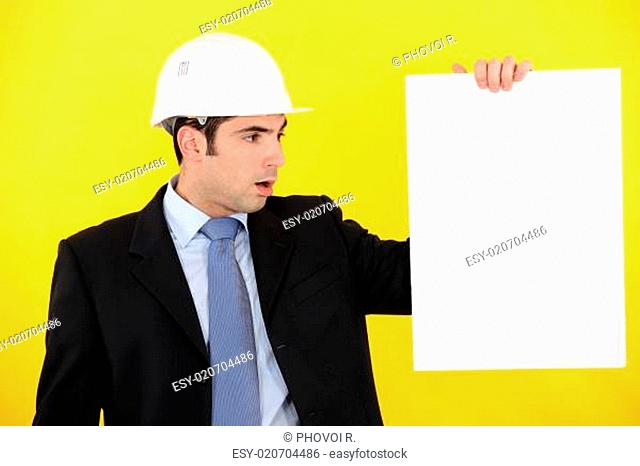 Architect stood with blank poster