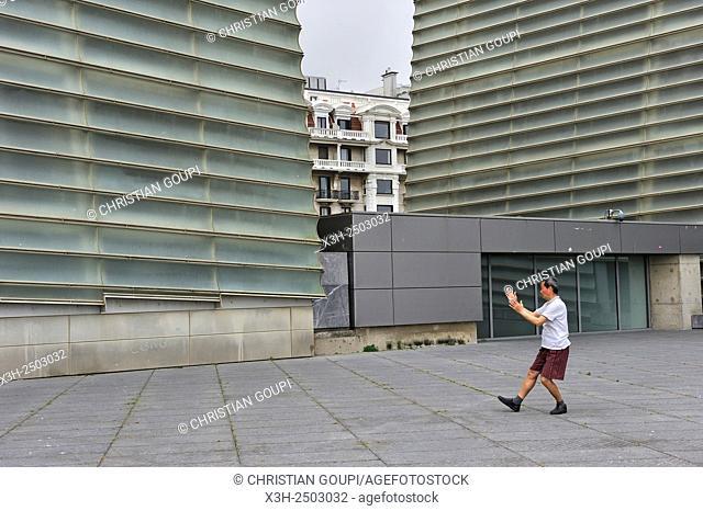 man practising Tai-Chi on esplanade of Kursaal Congress Centre and Auditorium by Spanish architect Rafael Moneo, San Sebastian, Bay of Biscay