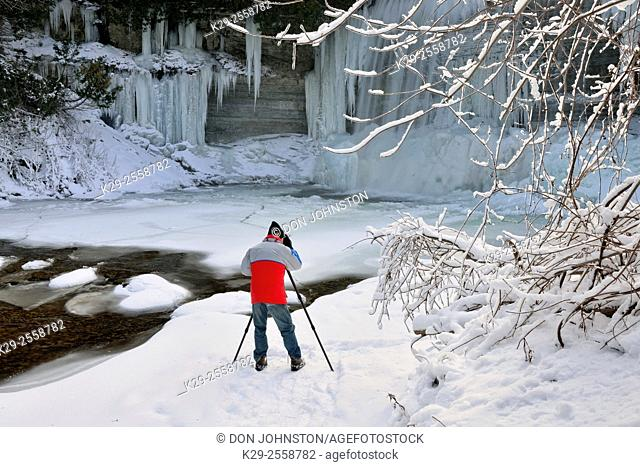 Photographer below Bridal Veil Falls and the Kagawong River in Winter, Kagawong, Manitoulin Island, Ontario, Canada