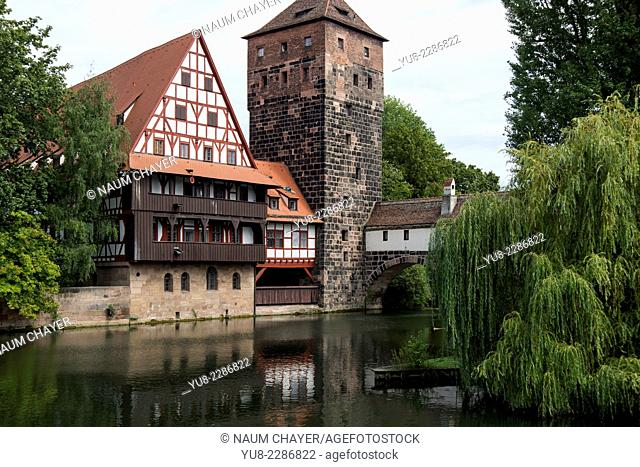 Beautiful view of Nuremberg with river, hotel, and tower of medieval castle, Nürnberg, state of Bavaria, Middle Franconia, Germany, Europe