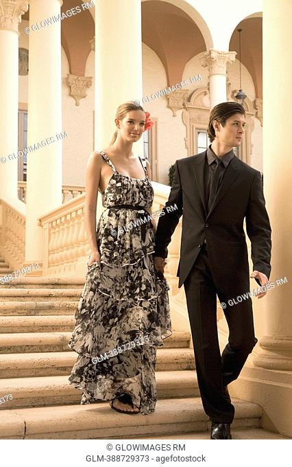 Couple moving down steps, Biltmore Hotel, Coral Gables, Florida, USA