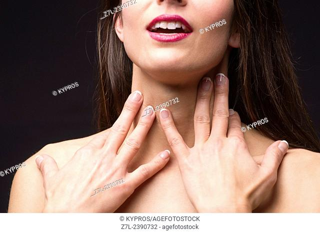 Young Brunette Woman Hand's Touching Neck