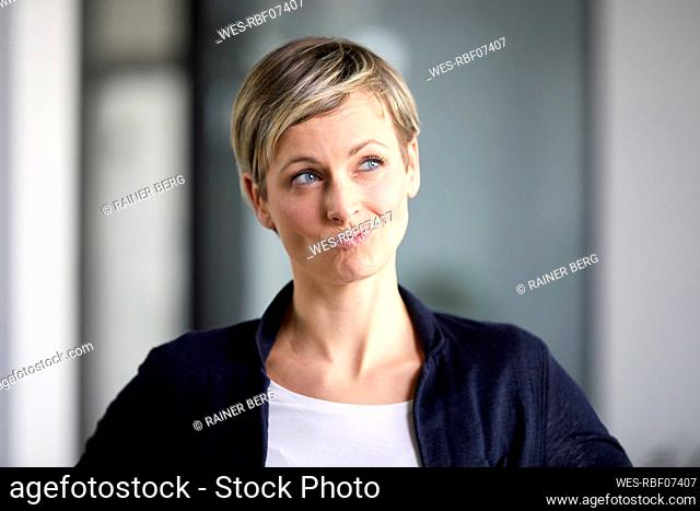 Portrait of a pensive businesswoman in office