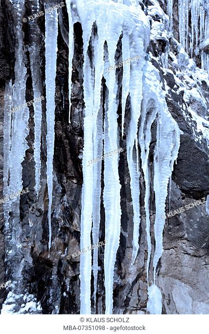 Icicles on a steep rock face