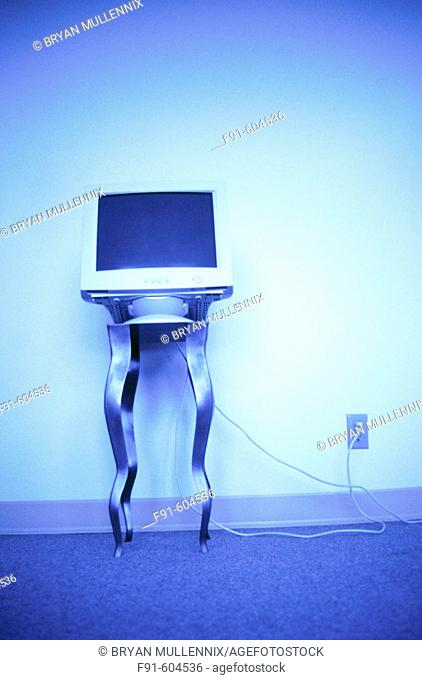 Computer monitor on table (toned blue)