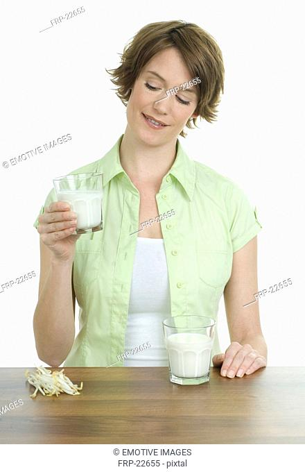Woman holding glass of soy milk