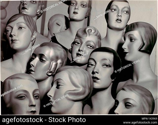 [Arrangement of 12 Female Mannequin Heads, Each with Distinct Physiognomy and Period Hair Style]. Artist: Peter Weller (German