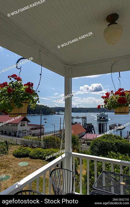 View of the Orcas Island Ferry Landing with an approaching ferry from the Orcas Hotel, a historic inn and cafe built 1904