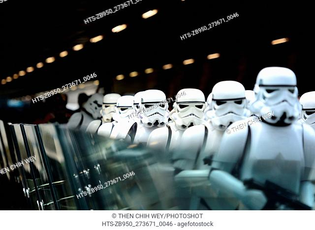 """(151112) -- SINGAPORE, Nov. 12, 2015 () -- Performers dressed as characters of the movie """"""""Star Wars"""""""" perform during the """"""""Star Wars"""""""" fighters unveiling..."""