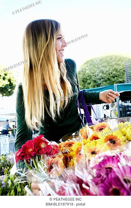 Caucasian woman shopping in flower market